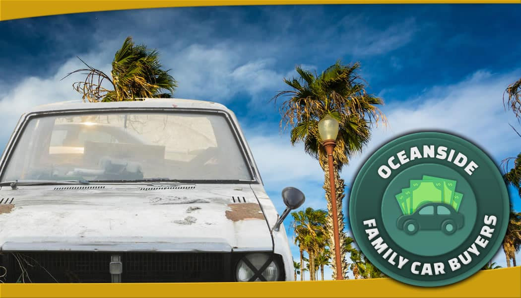 White junk car in front of Oceanside palm trees with the FCB emblem