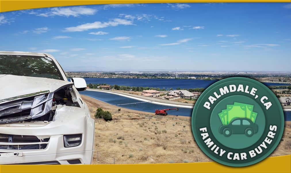 New white car with front end damage with panaramic view of Palmdale, CA and our FCB emblem
