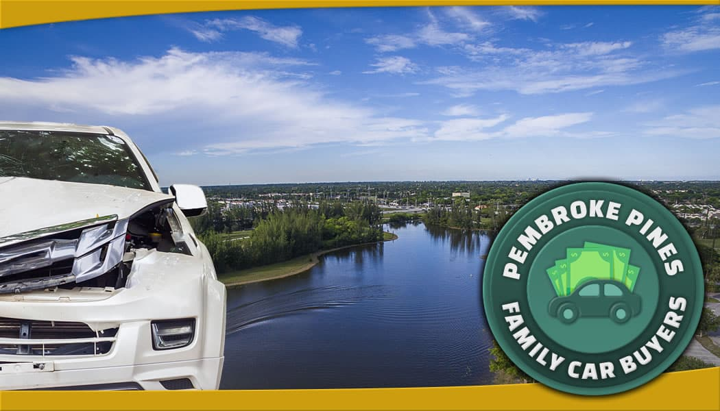 Junk car in front of panaoramic Pembroke Pines over the water and official FCB service area emblem