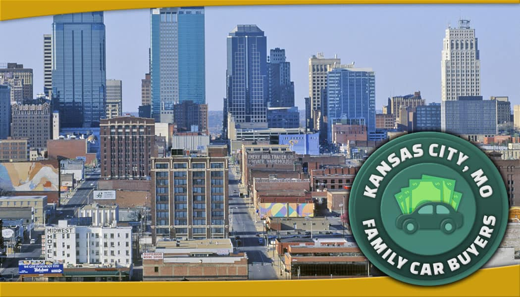 Kansas City, Missouri aerial photo of downtown at mid-day with green Family Car Buyers emblem