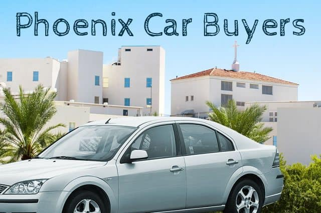 Used silver colored car in front of adobe style buildings in Phoenix