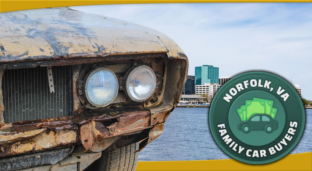 Brown rusted car in front of Norfolk, Virginia and Family Car Buyers emblem